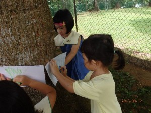 Children went outdoors to learn about the texture and other characteristics of the trees. The lessons ended with the children doing tree rubbings as a closure.